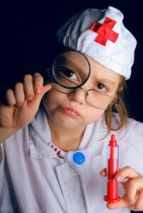 child dressed as Dr or a nurse